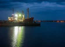 Ship at dock at night Stock Photography