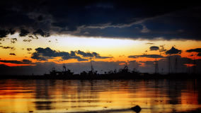 Ship dock silhouetted. A fishing boat dock at sunset Royalty Free Stock Images