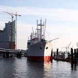 Ship docked alongside a jetty Stock Photography