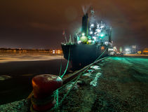 Ship docked at night. Stock Photo