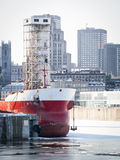Ship at port in city Stock Photos