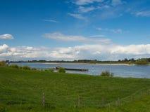 Ship drives the Rhine upstream, Grieth. Kalkar, Germany Royalty Free Stock Photo