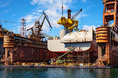 Ship in dry dock. Big ship under repairing on floating dry dock in shipyard Stock Photography
