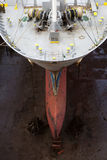 Ship in dry dock. The bulbous bow of a ship in dry dock at Falmouth, Cornwall, UK stock photos
