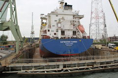 Ship in a dry dock. A cargo vessel is in the dry dock for repair and maintenance Royalty Free Stock Images