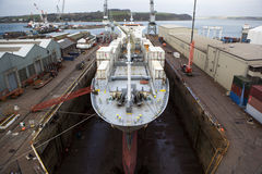 Ship in dry dock. A container ship in dry dock, Falmouth, Cornwall, UK royalty free stock photography
