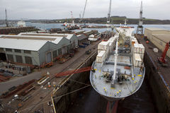 Ship in dry dock. A container ship in dry dock at Falmouth, Cornwall, UK Stock Photography