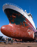 Ship in dry dock. For repairs and painting Royalty Free Stock Photos