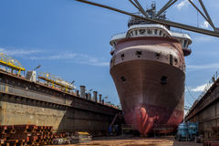 Ship in dry dock at the shipyard Royalty Free Stock Photography