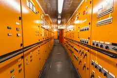 Ship electrical system switch board. Along a coridor Stock Photo