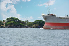 Ship entering harbour. When a ship re-enters its harbour, it heralds rest days for both the vessel and its crew. It is in fact sweet homecoming. The bright Royalty Free Stock Photography