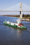 Ship entering port of Savannah. Talmadge Memorial Bridge Royalty Free Stock Image