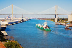 Ship entering port of Savannah. Talmadge Memorial Bridge Royalty Free Stock Photo