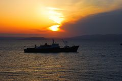 Ship in evening sea Stock Images
