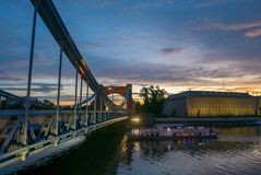 Ship excursion under beautiful bridge during sunset, Wroclaw. Ship excursion under beautiful bridge during sunset, Grunwaldzki bridge, Wroclaw, Poland Royalty Free Stock Photography