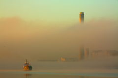 Ship and factory in fog. Royalty Free Stock Photos