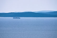 Ship by few islands on the horizon Royalty Free Stock Photos