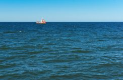 Ship, fishing, sea, waves, fishing, fish, mining, trailing, cruiser Royalty Free Stock Images
