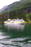 Ship in fjord. Royalty Free Stock Photo