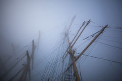 Ship with flags in the fog early morning. Regatta competition Royalty Free Stock Image