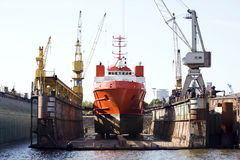 Ship in floating dry dock. Ship for repairs in large floating dry dock Stock Image