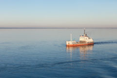 The ship floating by sea Stock Photography