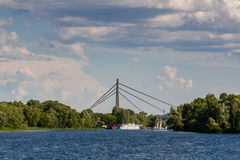 A ship that floats along the river with a view of the bridge royalty free stock images
