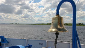 The ship floats on the river, The bell on the bow of the ship stock video footage