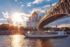 Ship of Flotilla Radisson Royal. Moscow River Cruise. The Cathedral of Christ the Savior at sunset. royalty free stock image