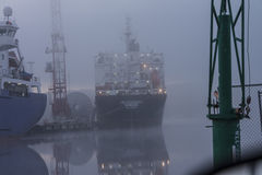 Ship in fog at the harbor Stock Photos