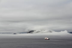 Ship in Foggy fjord Royalty Free Stock Images