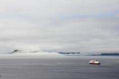 Ship in Foggy fjord Stock Photo