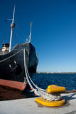 Ship fore. A photo of ship fore with ropes attached to quay Stock Photography