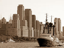 Ship in front of the skyline of Manhattan, New York City Royalty Free Stock Photography