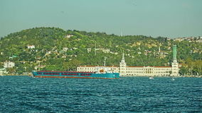 Ship in front of Vanikoy Mahallesi Muhtarligi. ISTANBUL, TURKEY - SEPTEMBER 29, 2013: Ship in front of Vanikoy Mahallesi Muhtarligi sailing Bosphorus stock video footage