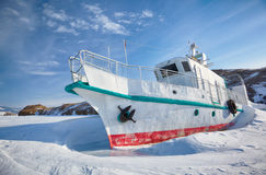 Ship in frozen baikal Stock Photos