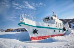 Ship in frozen baikal Stock Photos