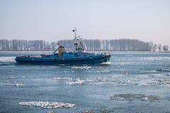 Ship on frozen Danube river in winter season from Romania. Cold, vessel, ship, Romania, winter season, Romania landscape, Danube river Royalty Free Stock Photos