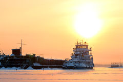 Ship in frozen river on Royalty Free Stock Images