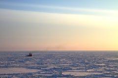 Ship in frozen sea Stock Photography