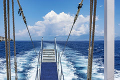 Ship gangway cash followed by a marine vessel Royalty Free Stock Photo
