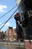 Ship in Gdansk. Ship, river and historic buildings in Gdansk (Poland Royalty Free Stock Images