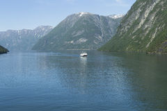 Ship in Geiranger fjord. Image shows a ferry boat in Geiranger Fjord stock images