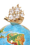 Ship on the globe. Isolated on white Royalty Free Stock Photo