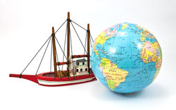 Ship and globe. Ship and the globe isolated on white background Royalty Free Stock Image