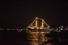 Ship glowing in the sea. At night Stock Images