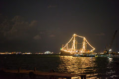 Ship glowing in the sea. At night Stock Photo