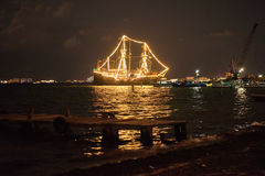 Ship glowing in the sea. At night Royalty Free Stock Image