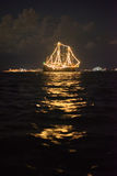 Ship glowing in the sea. At night Royalty Free Stock Images