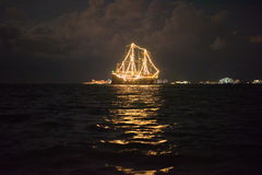 Ship glowing in the sea. At night Stock Photos